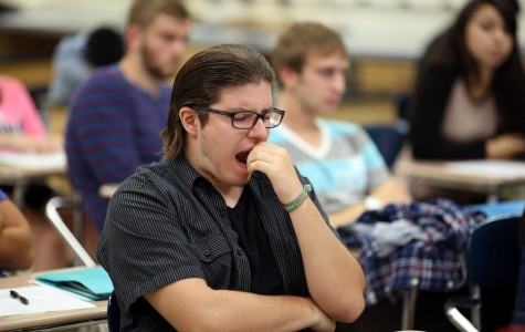 Matt Goodmanson, a junior, yawns during teacher Rich Schram's eighth period honors physics class Aug. 28, 2014 at Buffalo Grove High School in Buffalo Grove, Ill. The American Academy of Pediantrics issued a statement saying school start times should be pushed to 8:30 a.m. or later, as many students aren't getting enough sleep. (Brian Cassella/Chicago Tribune/MCT)