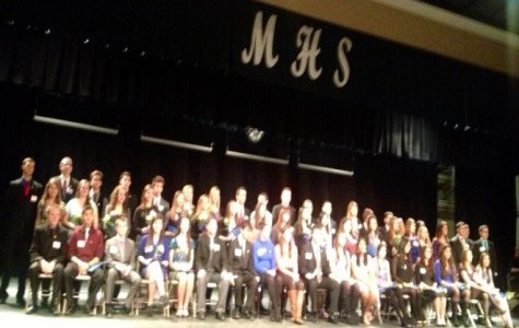 New member being inducted at the 2013 National Honor Society induction. Photo by Rose El-helou
