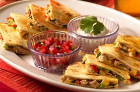 The Chicken Quesadilla is an appetizer that sells for less during happy hour.  Photo by official Bahama Breeze website.