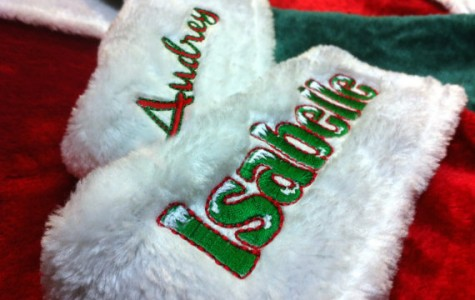 Laurie Coppersmith embroiders personalized stockings running at $25.99. Photo by Laurie Coppersmith