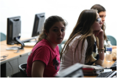 Yearbook students Dana Luciano, Felice Ferrante, and Jillian Rice are hard at work to insert their creative ideas.  Photo by John Sullivan.