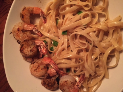 Outback Steakhouse's No Rules Parmesan Pasta is pictured here with grilled shrimp, costing $14.99. The delightfully creamy dish can be served with chicken as well.