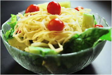 Pizzazz's famous dinner salad comes topped with shredded provolone and fresh tomatoes.  It's served with a side of Pizzazz's creamy house Italian dressing.