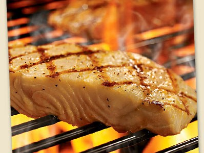The fire-grilled salmon is one of many seafood options on the menu.
