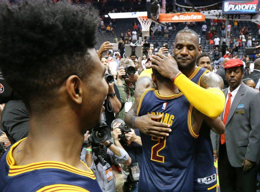 Cleveland+Cavaliers%27+Iman+Shumpert+looks+on+as+LeBron+James+gives+Kyrie+Irving+a+hug+celebrating+a+four-game+sweep+over+the+Atlanta+Hawks+on+Sunday%2C+May+8%2C+2016%2C+at+Philips+Arena+in+Atlanta.
