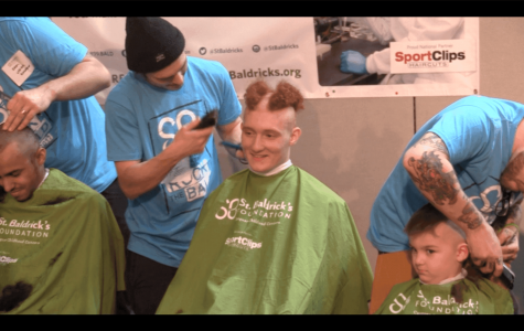 Senior Nedal Eid gets his hair shaved at Cleveland Clinic on Friday, March 10.