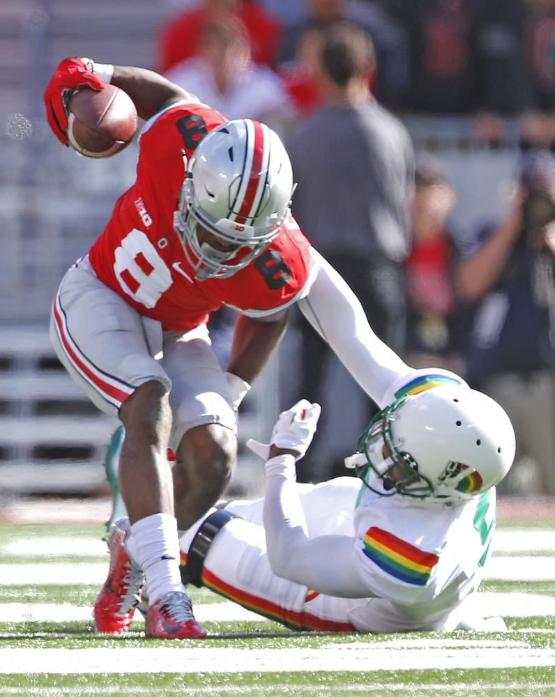 Former Ohio State defensive back Gareon Conley intercepts a pass in a 2015 game against Hawaii.  Conley was drafted later than predicted after a young woman alleged that Conley raped her in a Cleveland hotel.
