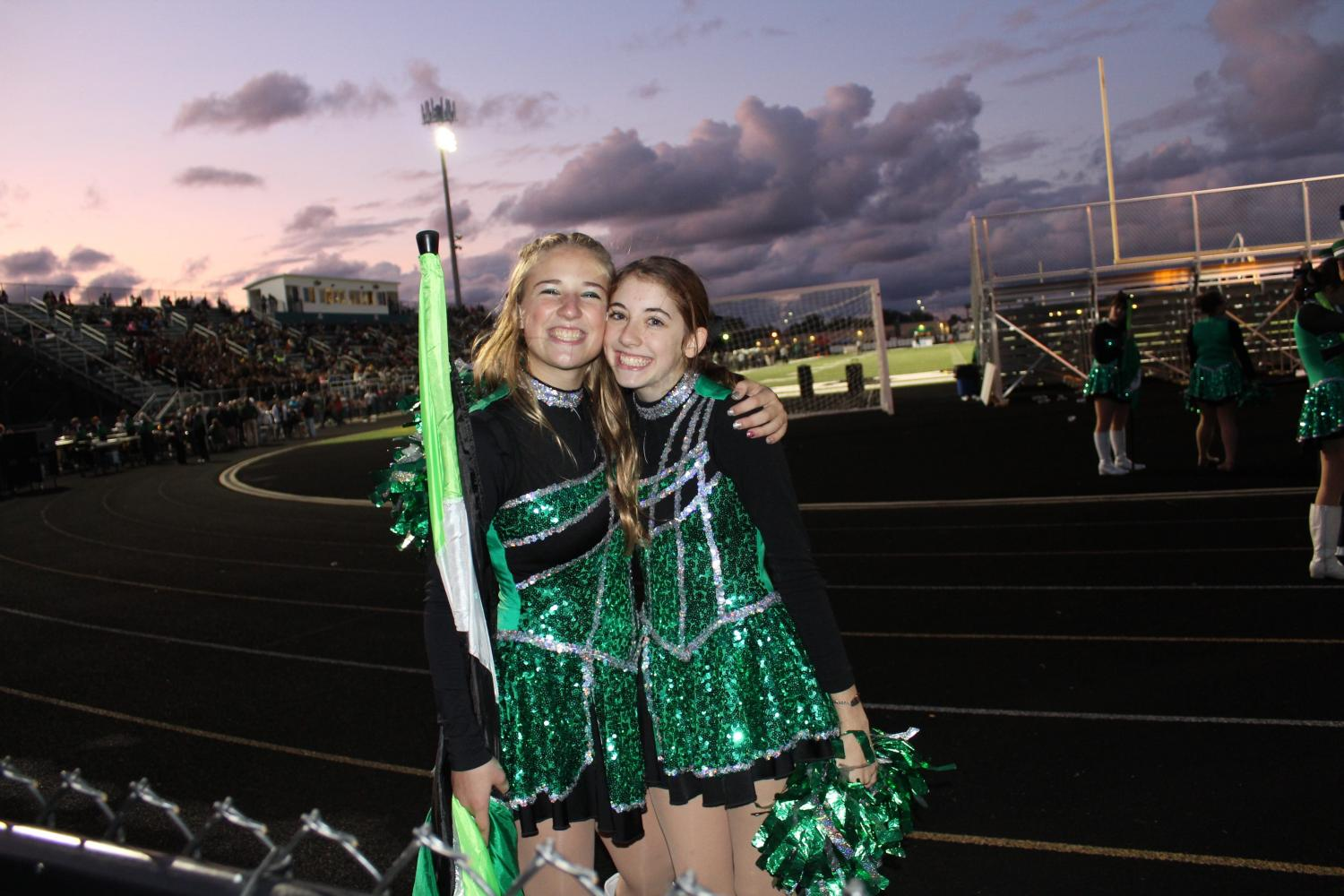 Sophomore Elise Holfeltz-a flag- and  sophomore Jenna Loprich - a catette (left to right).