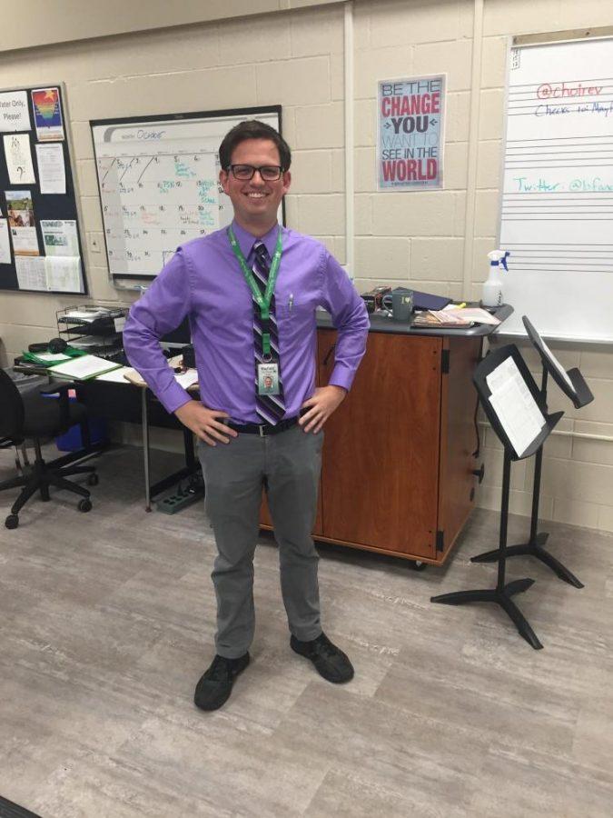 Music teacher shows his purple pride