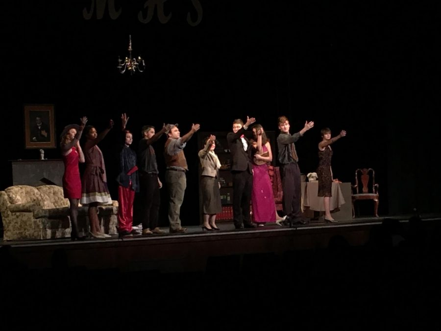 The+cast+celebrates+the+completion+of+one+of+their+three+performances.