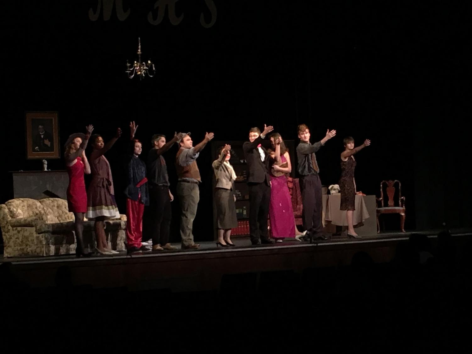 The cast celebrates the completion of one of their three performances.