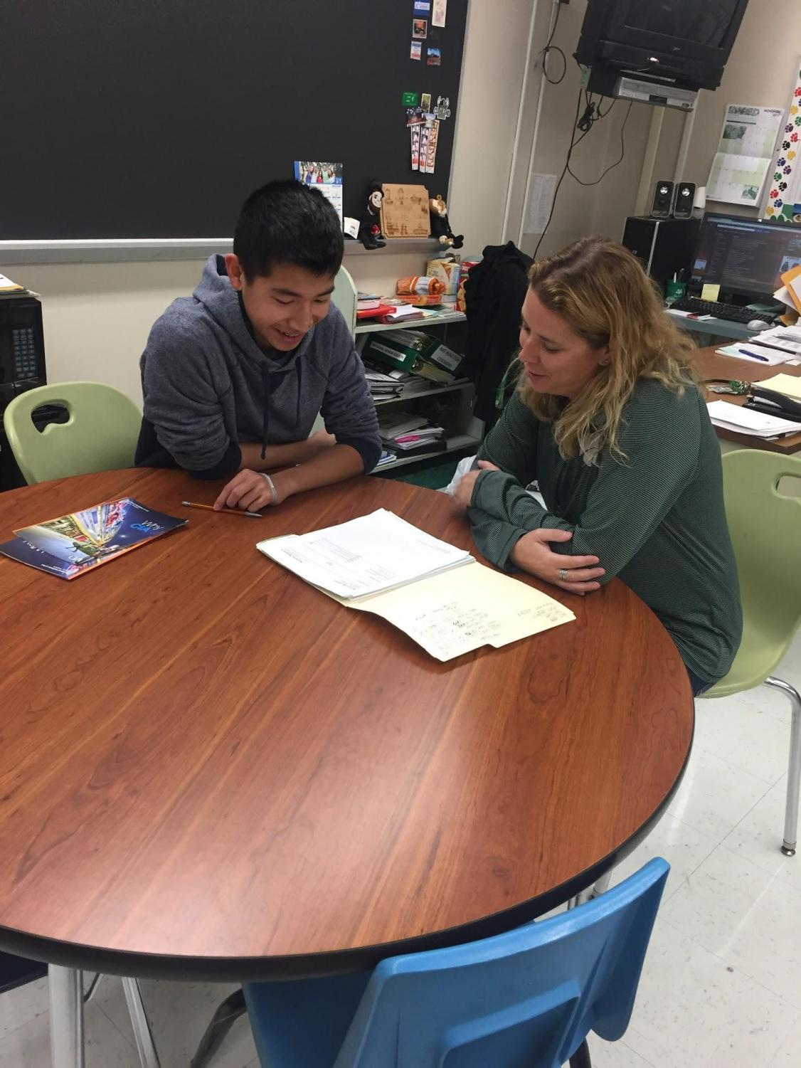 If homeroom is eliminated, students may have advisory time to work on-on-one with staff members.  Pictured: Trenton Lam and AEP teacher Jen Hyland.