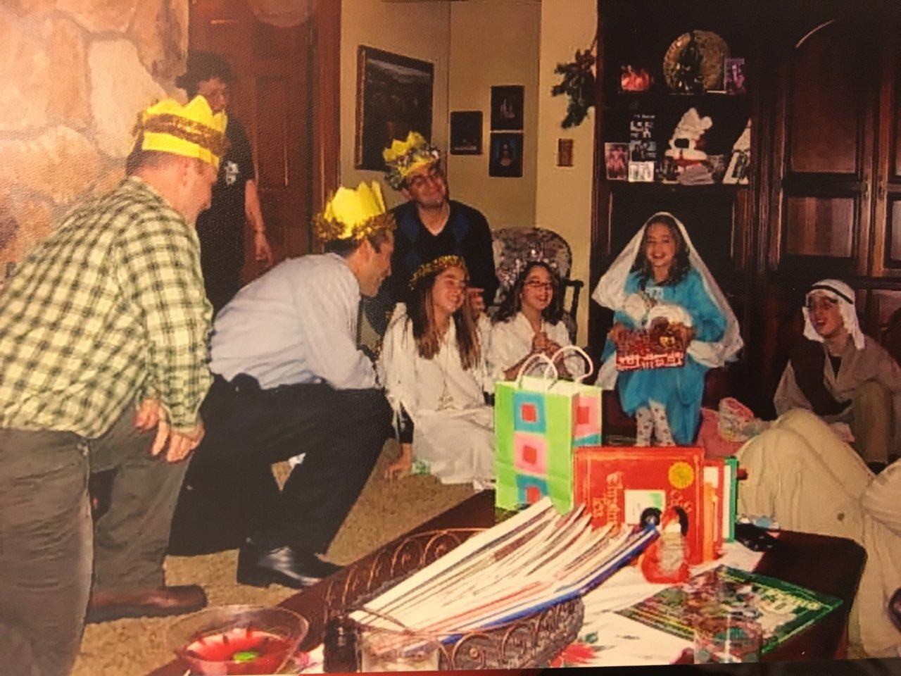 The Casey family smiling, decked out in their costumes,  as the gifts are being presented to baby Jesus at the  climax of the play.