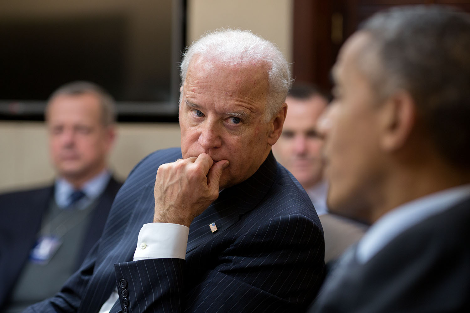 Vice President Joe Biden listens to President Barack Obama during a meeting in the Situation Room of the White House, Feb. 2, 2015.