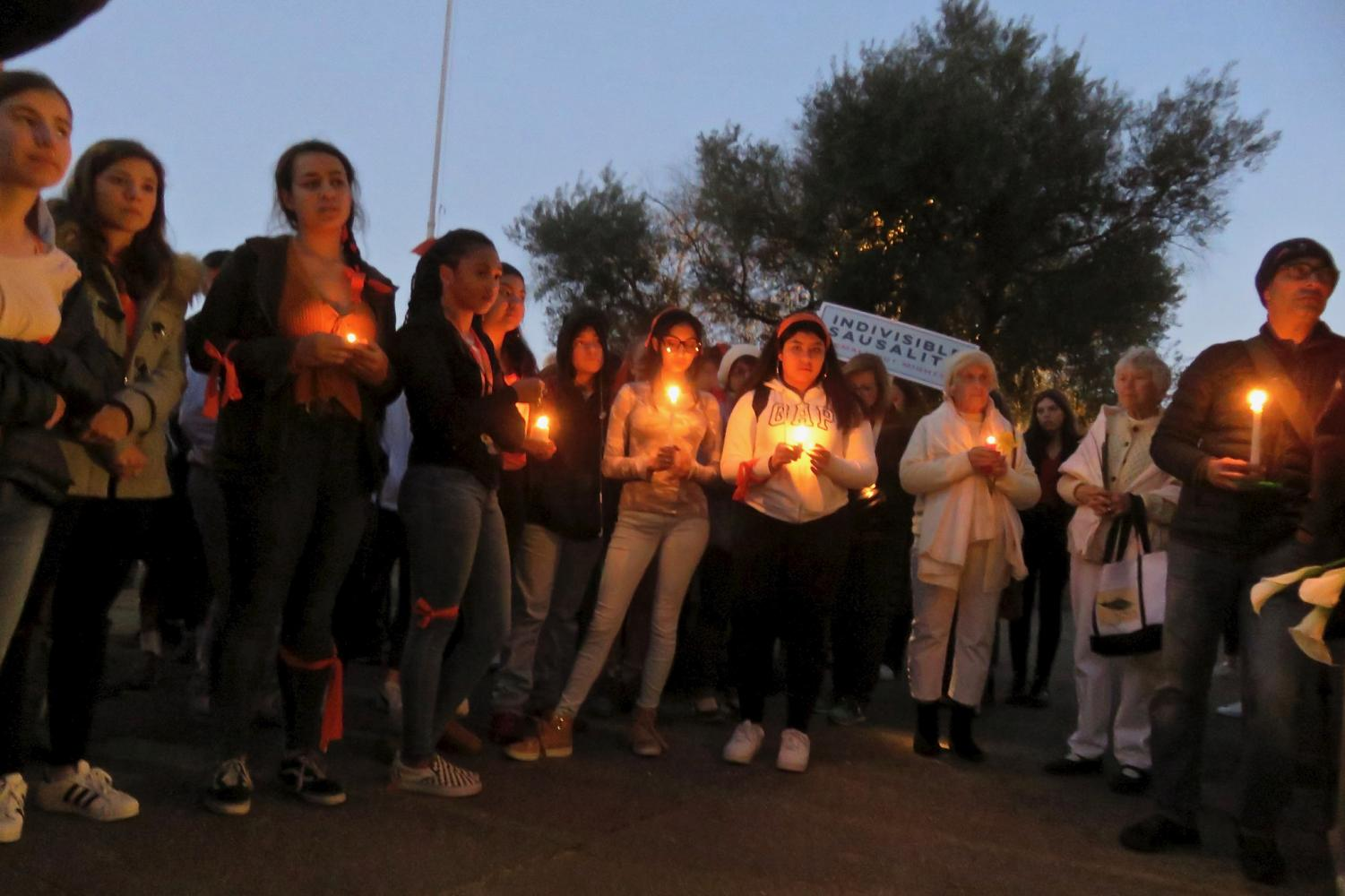 Students at Tam High School hold a candlelight vigil for the victims of the recent school shooting in Parkland, Florida.