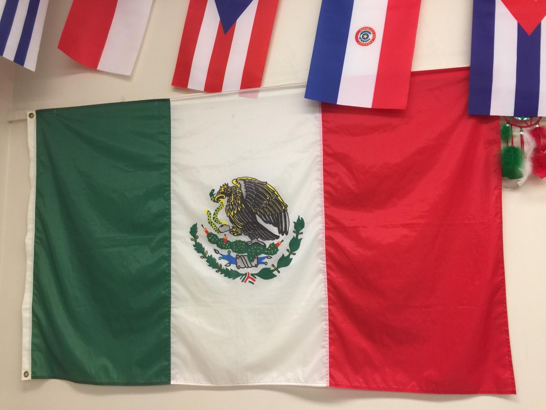 Oscar Sarmiento proudly hangs the Mexican flag in his classroom.