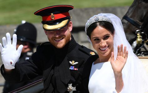 Prince Harry and Meghan Markle ride in an Ascot Landau after their wedding ceremony to Prince Harry at St. George's Chapel in Windsor Castle.