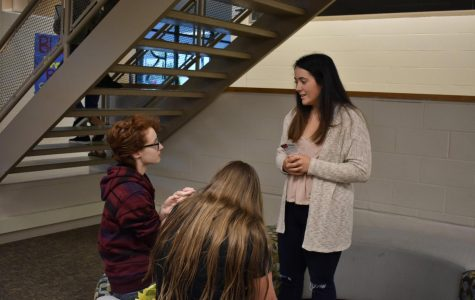 Senior class officer Bailey Ross chats with new students at the annual student breakfast.