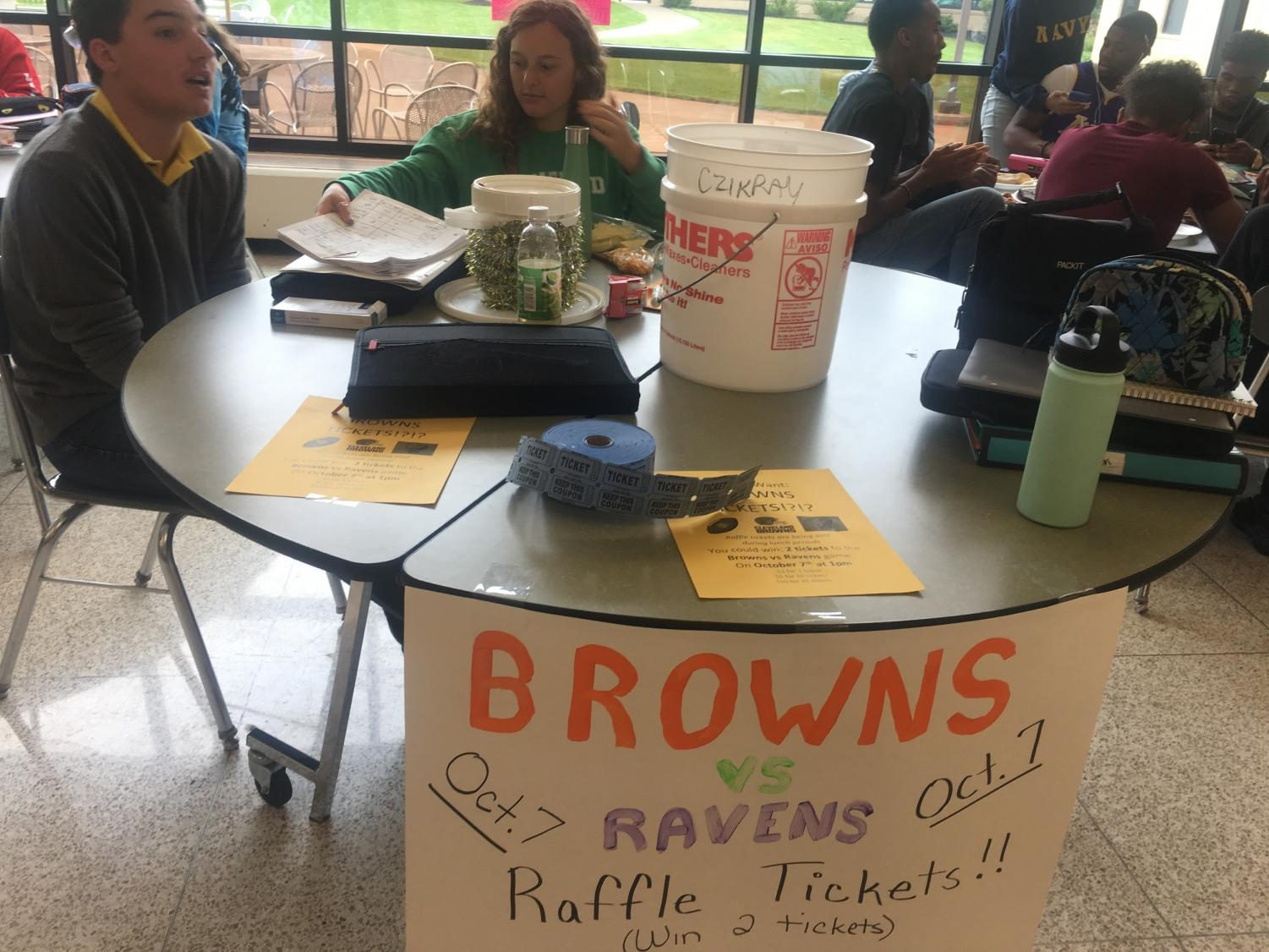 Senior and co-president of Cats Cabinet Elizabeth Reisman sells raffle tickets during her lunch period.  Reisman and many other MHS students keep busy with clubs and sports.