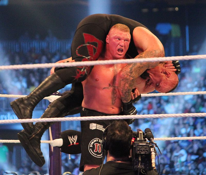 Justin+Stafford+aspires+to+be+like+wrestler+Brock+Lesnar%2C+who+prepares+to+body+slam+the+Undertaker+at+Wrestlemania+XXX+in+2014.