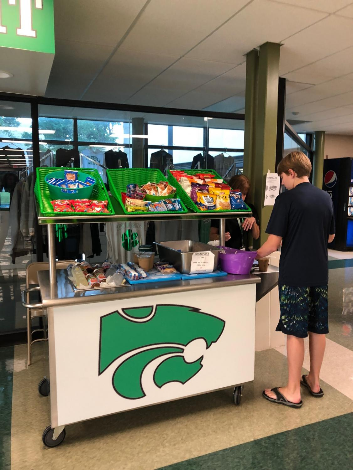 Sophomore Ethan Barnes purchases breakfast on his way to first period.