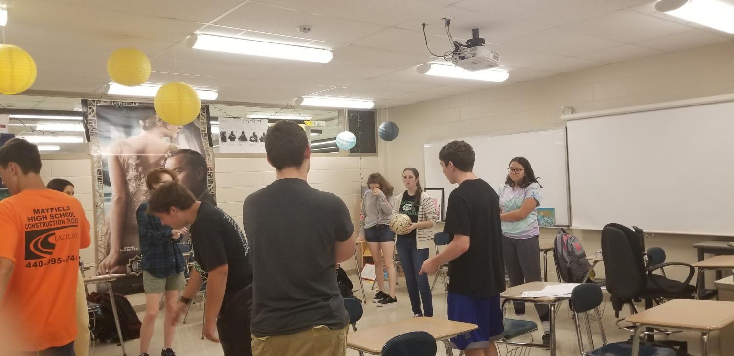 Improv Club prepares to play Loser Ball at its first club meeting of the year.  Standing in the center, holding the ball, is English teacher and club adviser Alex Shaw.