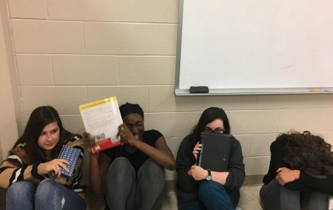 Students effectively get into the lockdown position while the ALICE process is beginning.