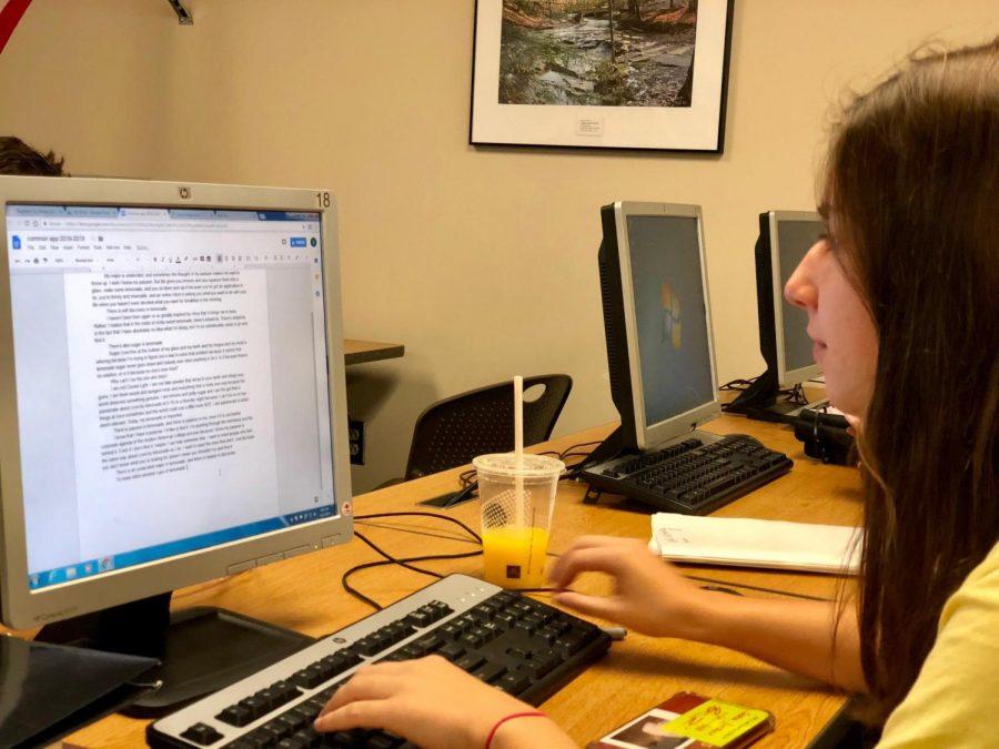Senior Sasha Borshev works on her Common App college essay early on Friday, Sept. 14 in the Library Media Center.