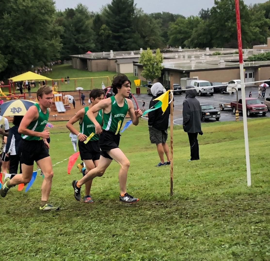 Juniors Ignacio Veloz and Henry Suster, and senior Hayden Palmer fighting to get up the hill at the Brecksville Invitational.