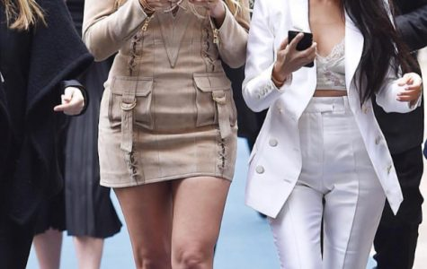 GET CONNECTED: Kardashian sisters Khloe and Kourtney focus on their social media empires.