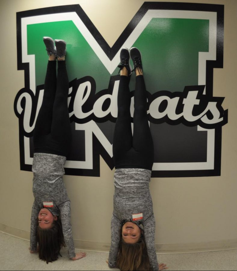 Senior+Abby+Withrow+and+junior+Becca+Fritz+show-off+their+handstand+skills+at+Media+Day+on+Friday%2C+Nov.+9.