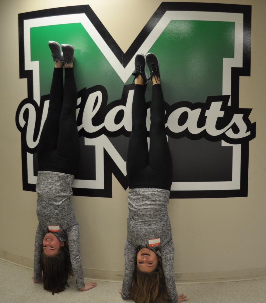 Senior Abby Withrow and junior Becca Fritz show-off their handstand skills at Media Day on Friday, Nov. 9.