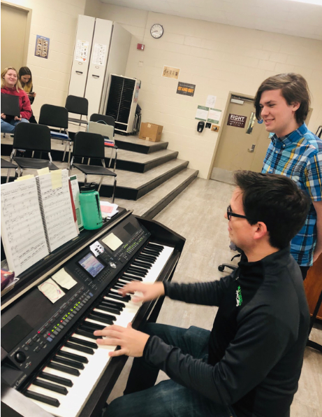Brian Fancher (front) rehearses an audition song with Nick Korzhiletsky as he prepares to audition for the role of Lord Farquad.