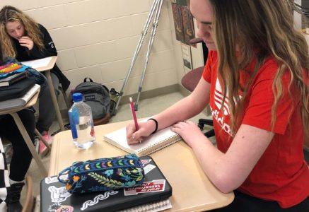 Junior catches up on school work after accident