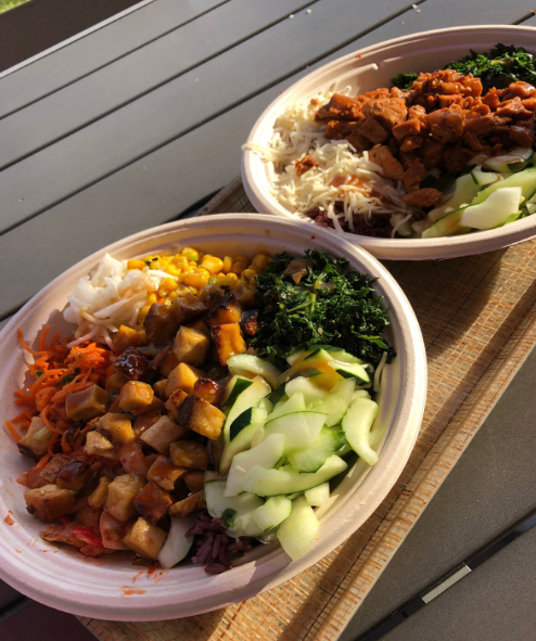 Customized rice bowls with seasoned chicken and crunchy tofu are packed with fresh vegetables and all sauces on the side.