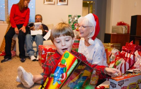 A family celebrates Christmas with the tradition of opening presents together.