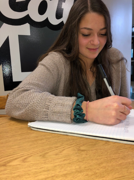 Principal Advisory Committee member, Gianna Ferrante works on a list of new classes she wants to see at the school in the future.