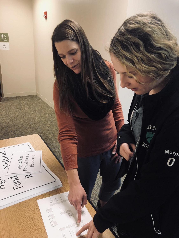 Counselor Pamela Bobinski explains career day to junior Mia Murphy.