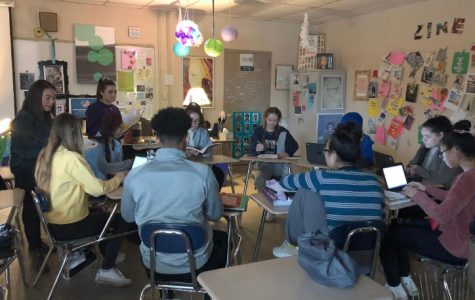 The eighth period Creative Writing class works on and discusses VOICE'S Magazine submissions.