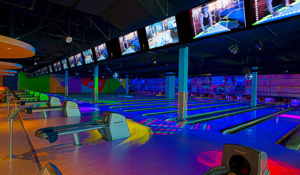 Consider cosmic bowling at Round 1 at the Great Lakes Mall.  Its offered after 8pm on weekdays and after 6pm on weekends.