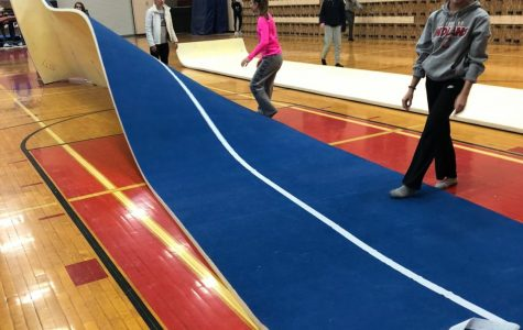 Gymnasts take on responsibility of set-up, tear-down