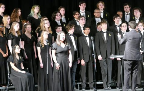 Choir director Brian Fancher (right) leads the chorale at the Winter Choral concert on Tuesday, March 5.
