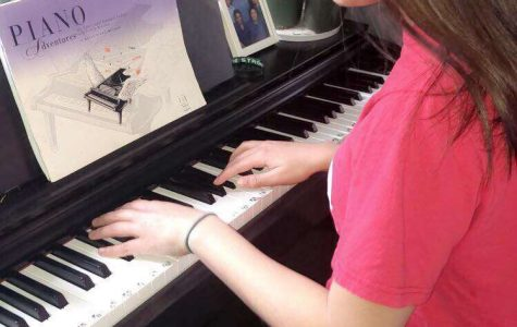 Mackenzie Michaud practices playing piano for the Talent Show.