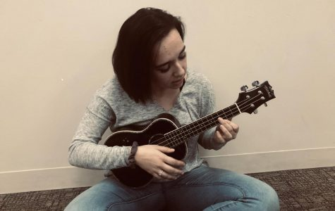 Junior Angelina Beukemann practices her ukulele in the Senior Commons.  She'll be performing at Open Mic Night on Friday.