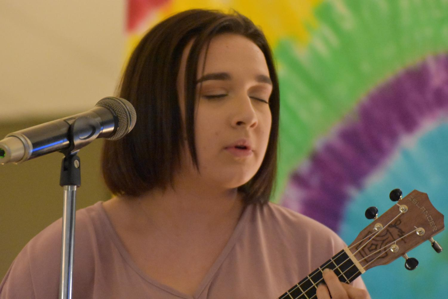 Junior Angelina Beukemann performs a song on the ukulele at Open Mic Night.  The event was a successful fundraiser for the junior class, as they have been raising funds to subsidize the cost of prom tickets.