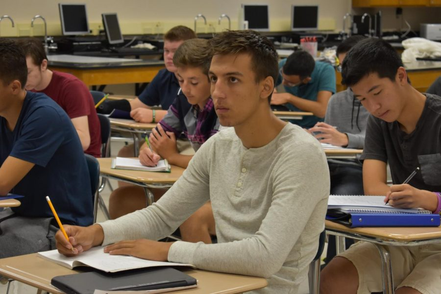 Senior Jeremy Cyncynatus listens intently in Dr. Selent's AP Physics course.  Cyncynatus is taking two AP courses this year.