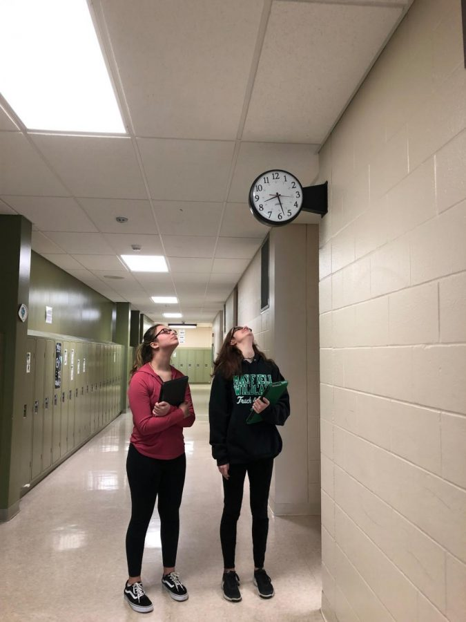 Sophomores Mia Rapposelli and Hannah Miller gaze at the clock, questioning whether they can make it to class on time in the morning.