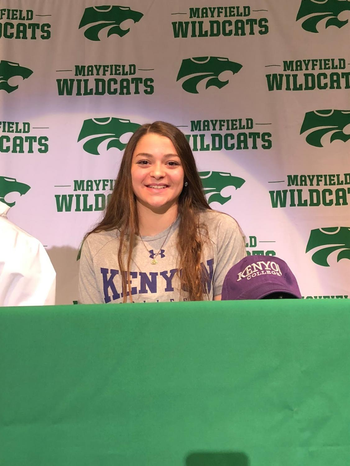 Senior Gianna Ferrante, a four-time state qualifier in swimming, officially committed to Kenyon College this week.  Principal Jeff Legan referred to Ferrante as