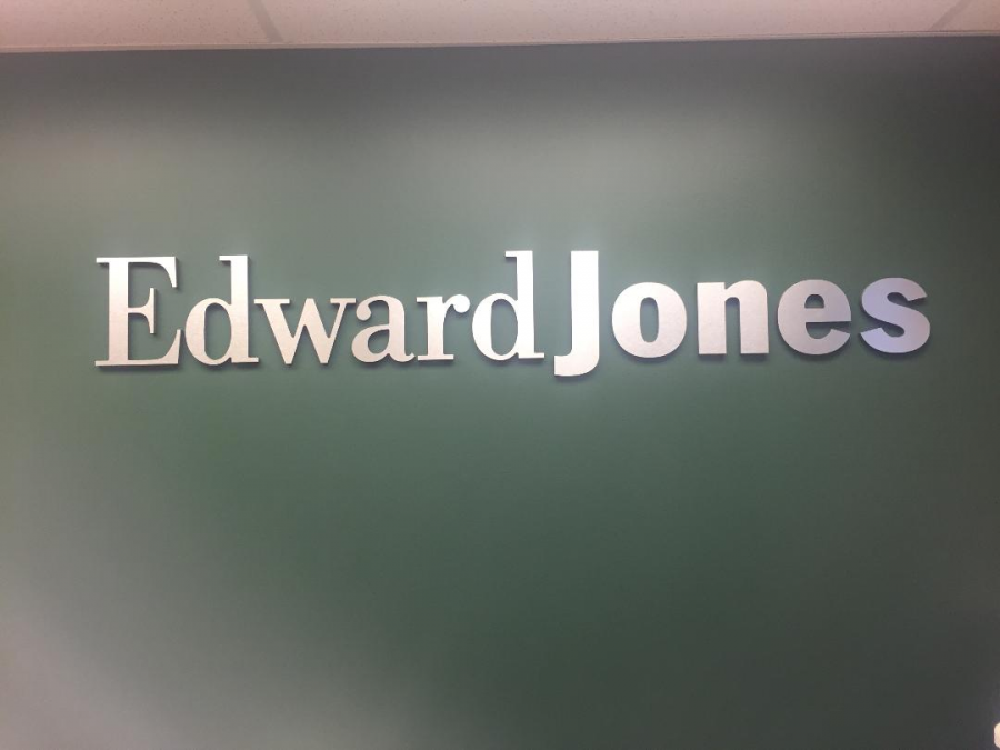 A+large+Edward+Jones+sign+welcomes+clients+as+they+enter+the+Highland+Heights+firm.+