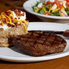 The eight ounce sirloin steak comes with a loaded baked potato and house salad.
